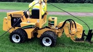 TRENCHER/VIBRATING PLOW